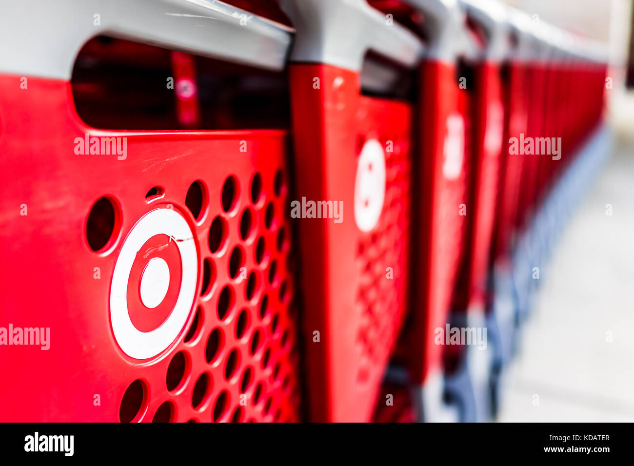 Fairfax, USA - September 21, 2017: Many rows of red shopping carts outside by store with closeup by Target store - Stock Image