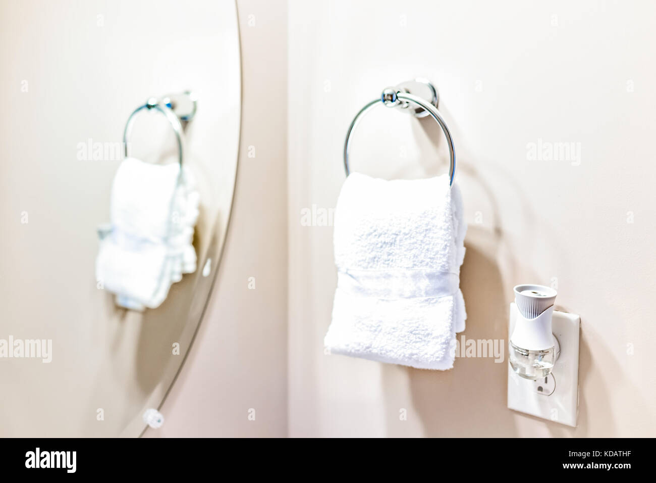 hanging white towel. Staging Modern Bathroom With One Small White Towel Hanging On Rack In Model Home, Apartment Or House Air Freshener And Mirror Reflection