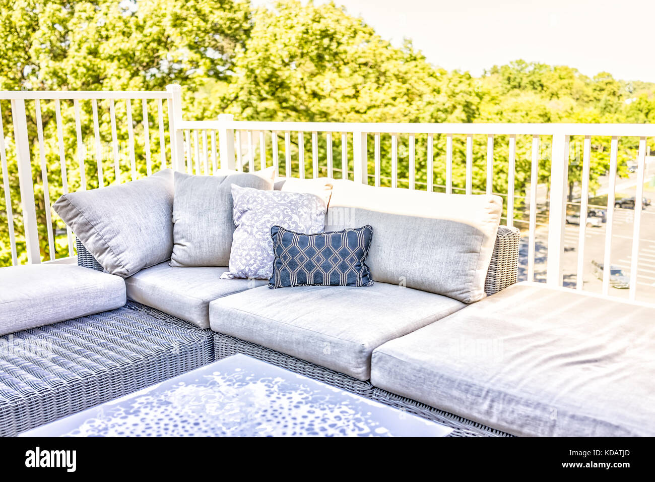 view of comfortable modern corner couch sofa with many pillows stock