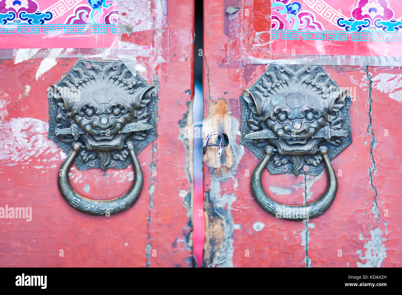 Classic Chinese bronze lion head door knocker at Hutong alley in Beijing, China - Stock Image