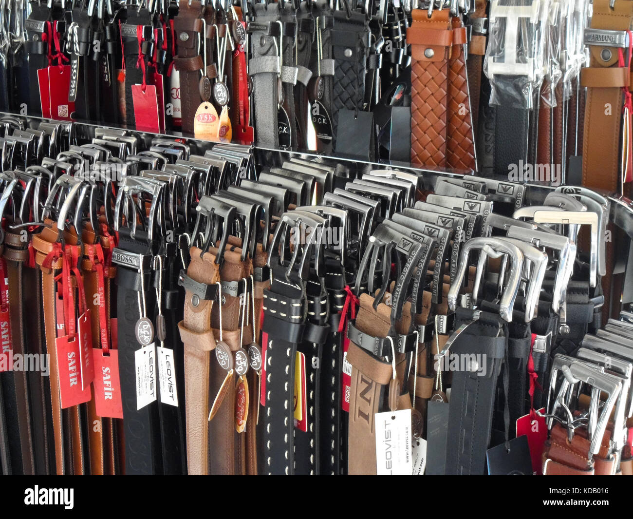 A shop display of mens leather and plastic trouser belts, Icmeler, Turkey, Europe. - Stock Image
