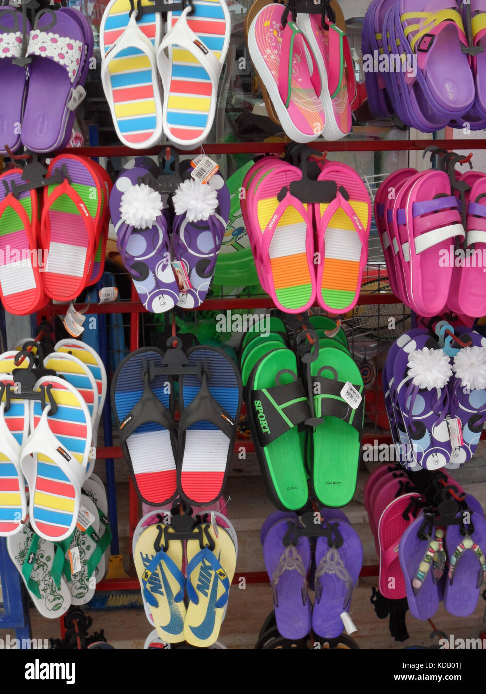 A market stall display of colourful flip flop sandals for sale, Marmaris, Turkey - Stock Image