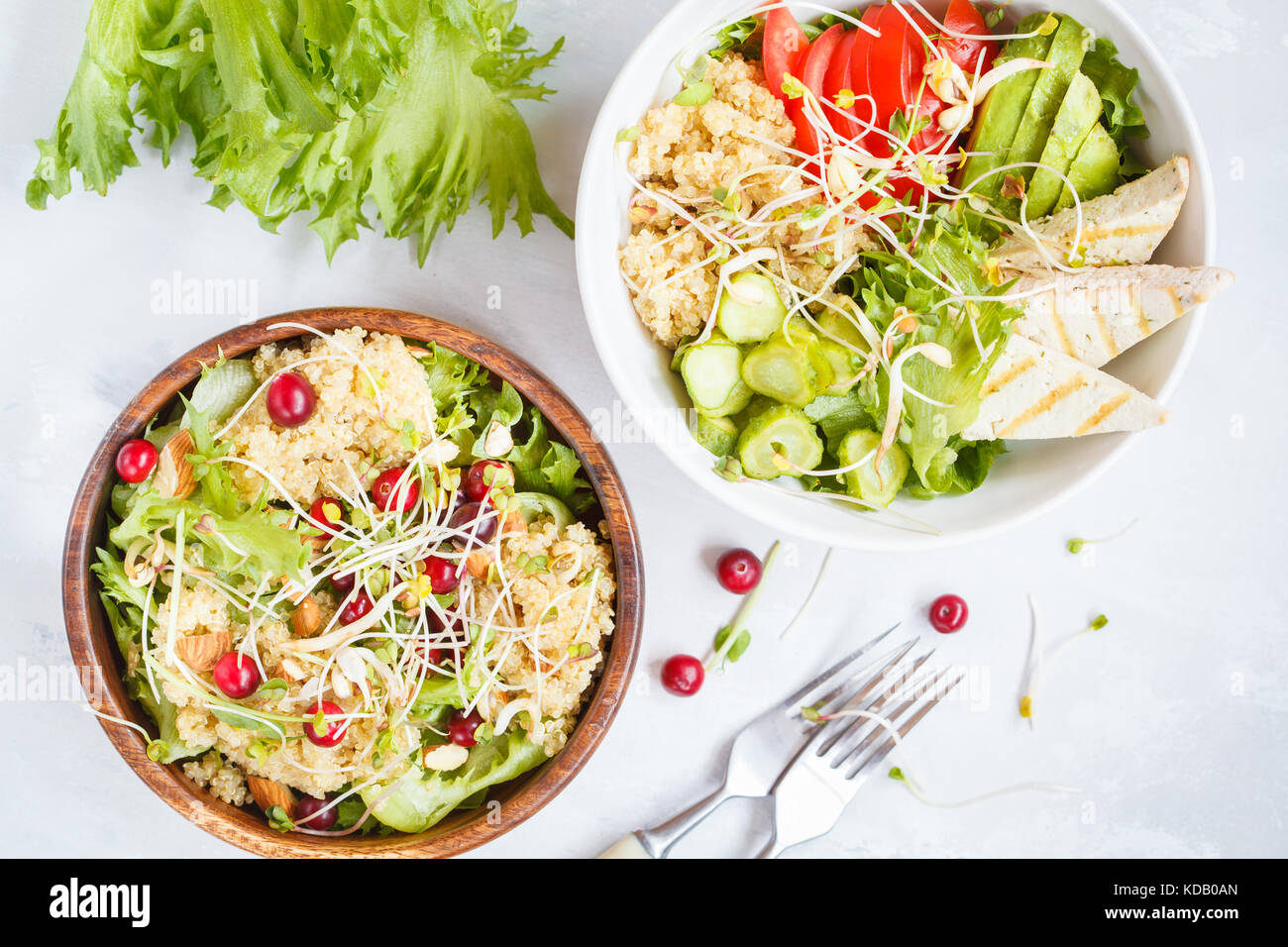 Salads with quinoa and vegetables. Vegan dinner concept, top view. - Stock Image