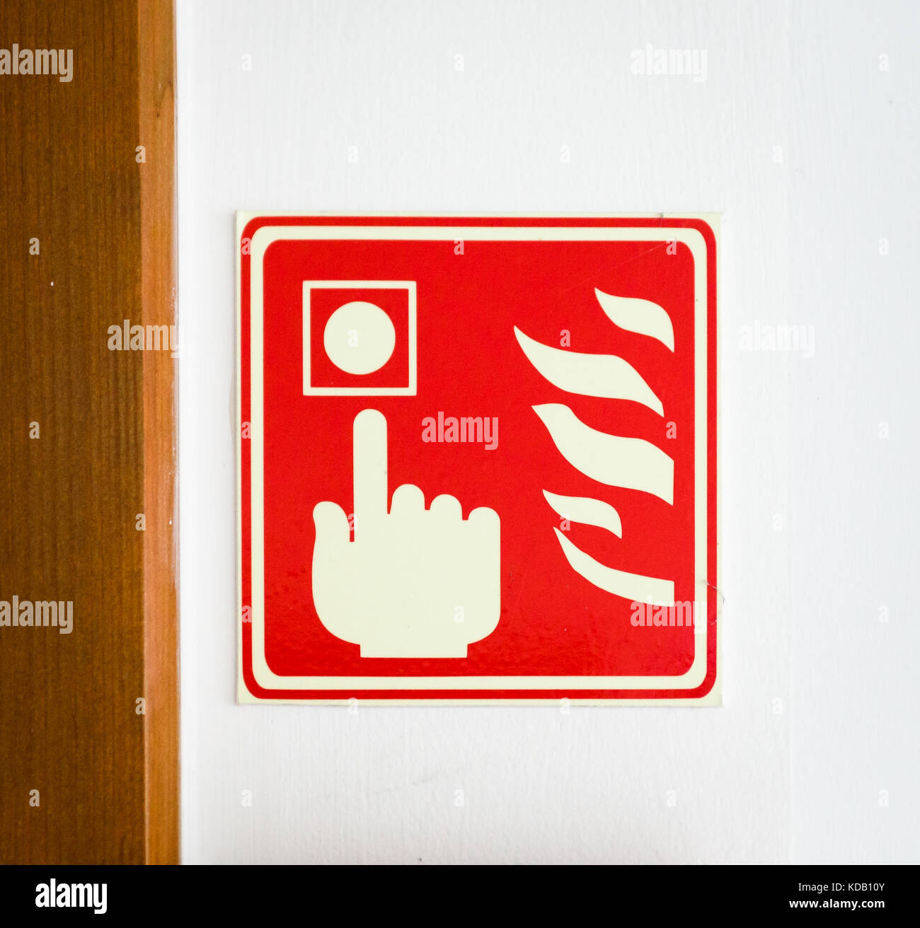 Emergency Fire Alarm Safety Call Point Sign On A Wall A Photograph