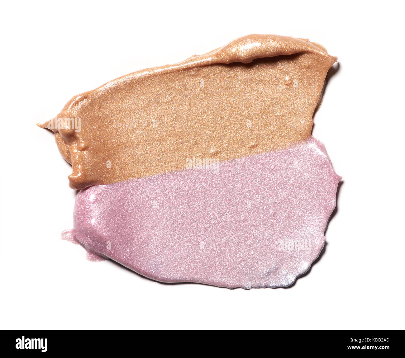 Collection of two tones smear crushed cosmetic products on a white background - Stock Image