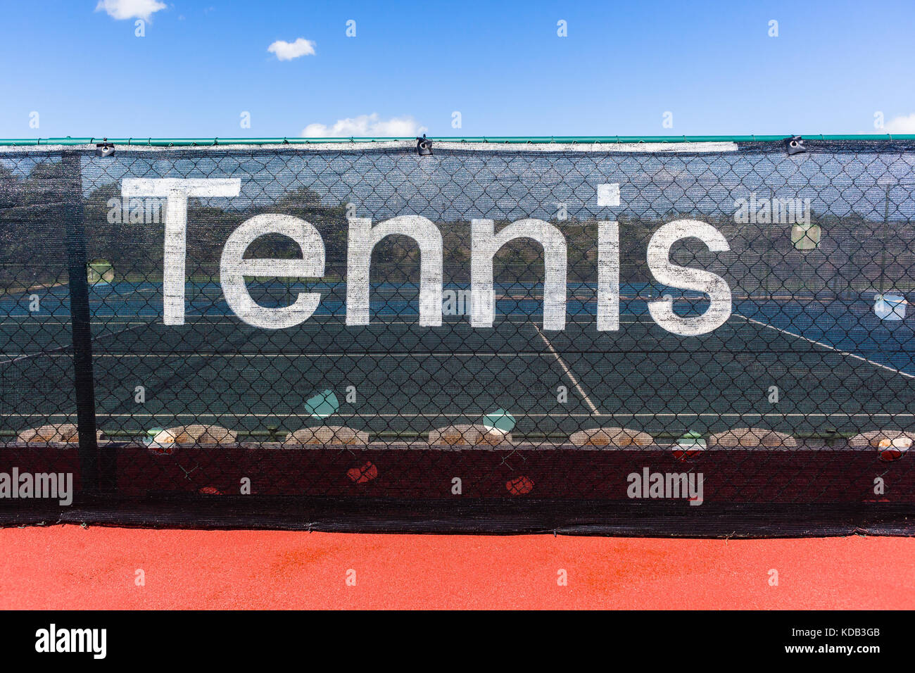 Tennis word sign on courts side screens outdoors closeup abstract photo. - Stock Image
