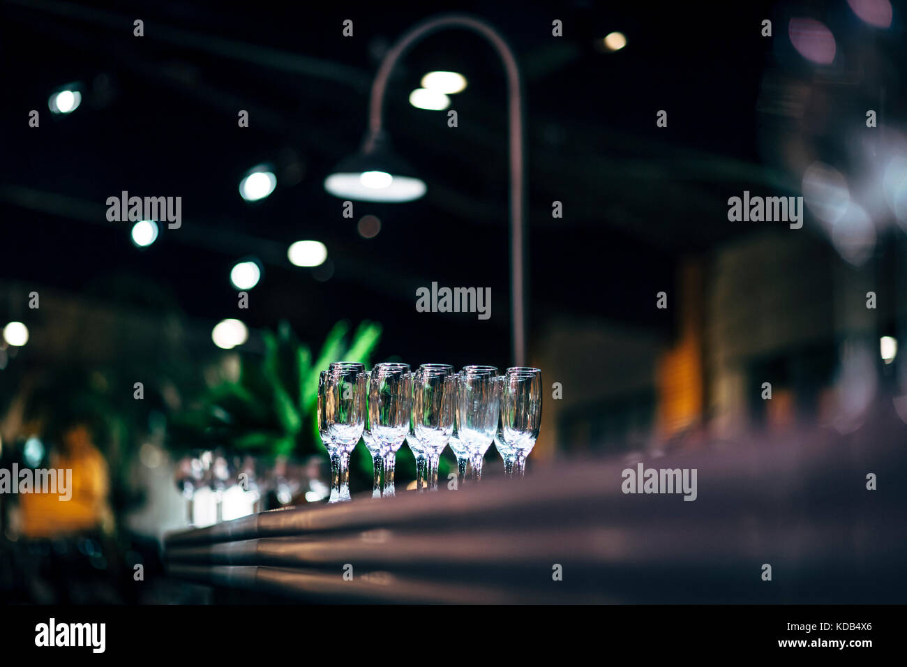 Luxury table settings for fine dining with and glassware beautiful blurred background. Preparation for holiday Christmas and Hannukah dinner night. & Luxury table settings for fine dining with and glassware beautiful ...