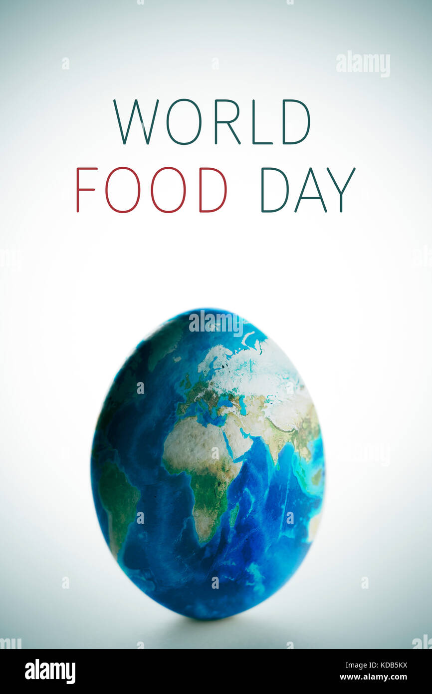 a chicken egg patterned with a world map (furnished by NASA) and the text world food day, on a white background - Stock Image