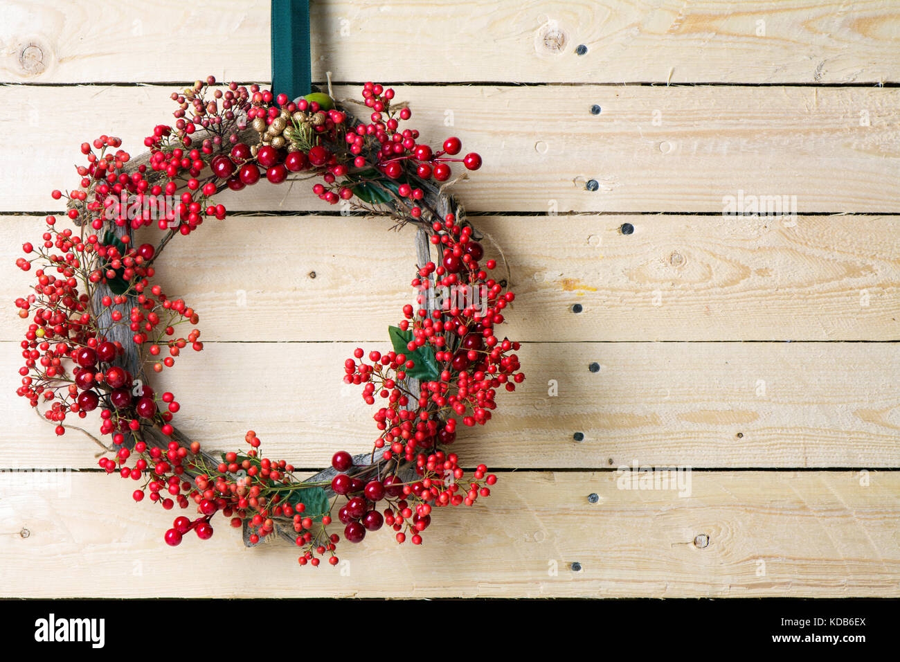 Christmas Wreath Of Evergreen And Berries On Wooden Background Natural Nandian Network Rustic Wood Crown