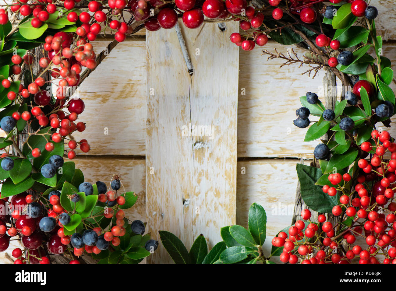 Christmas Wreath Detail Of Evergreen And Berries On Wooden Background Natural Nandian Network Green Branch Rustic Wood Crown