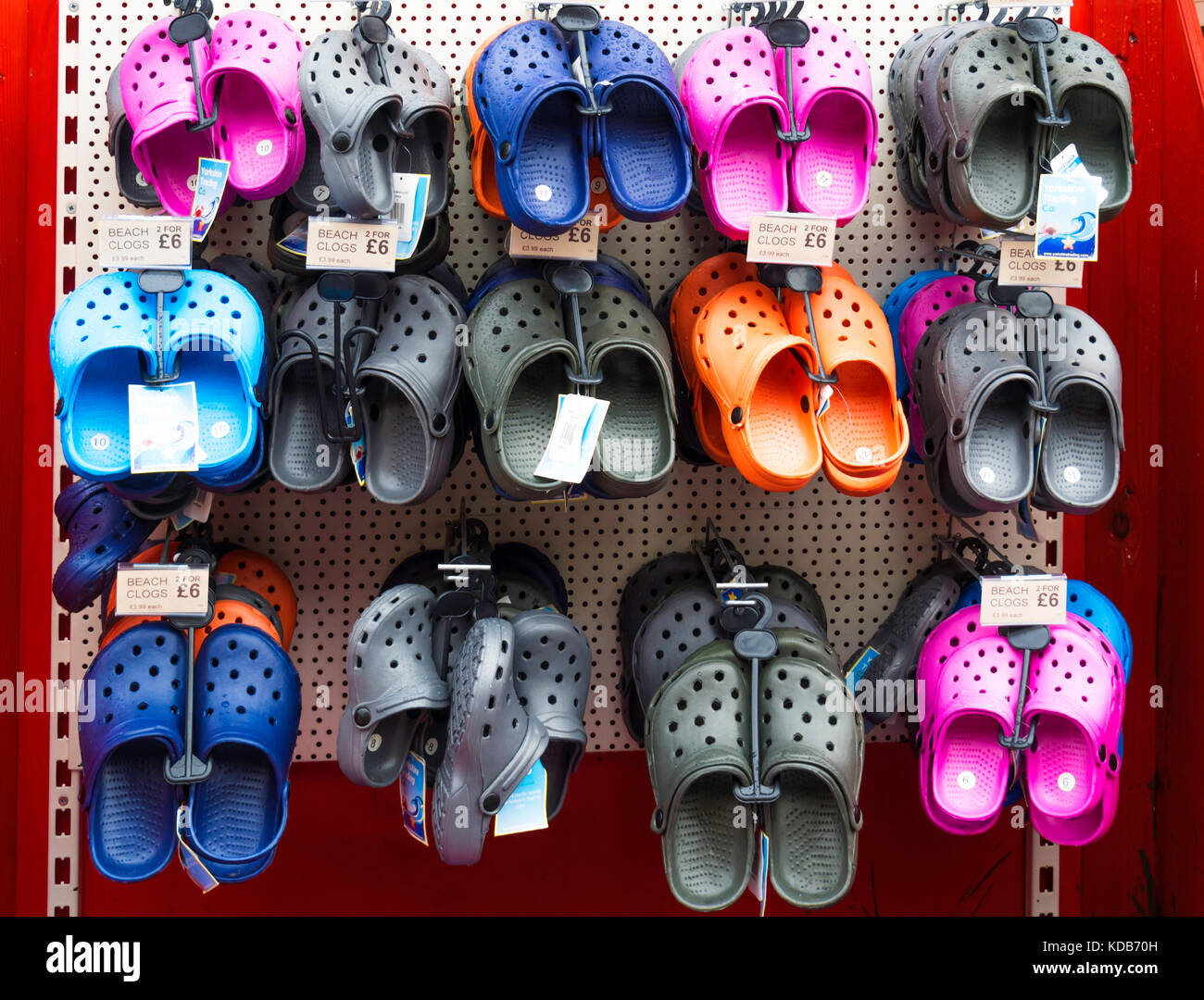 Plastic shoes, or Beach Clogs on sale at a tourist shop in North Yorkshire - Stock Image