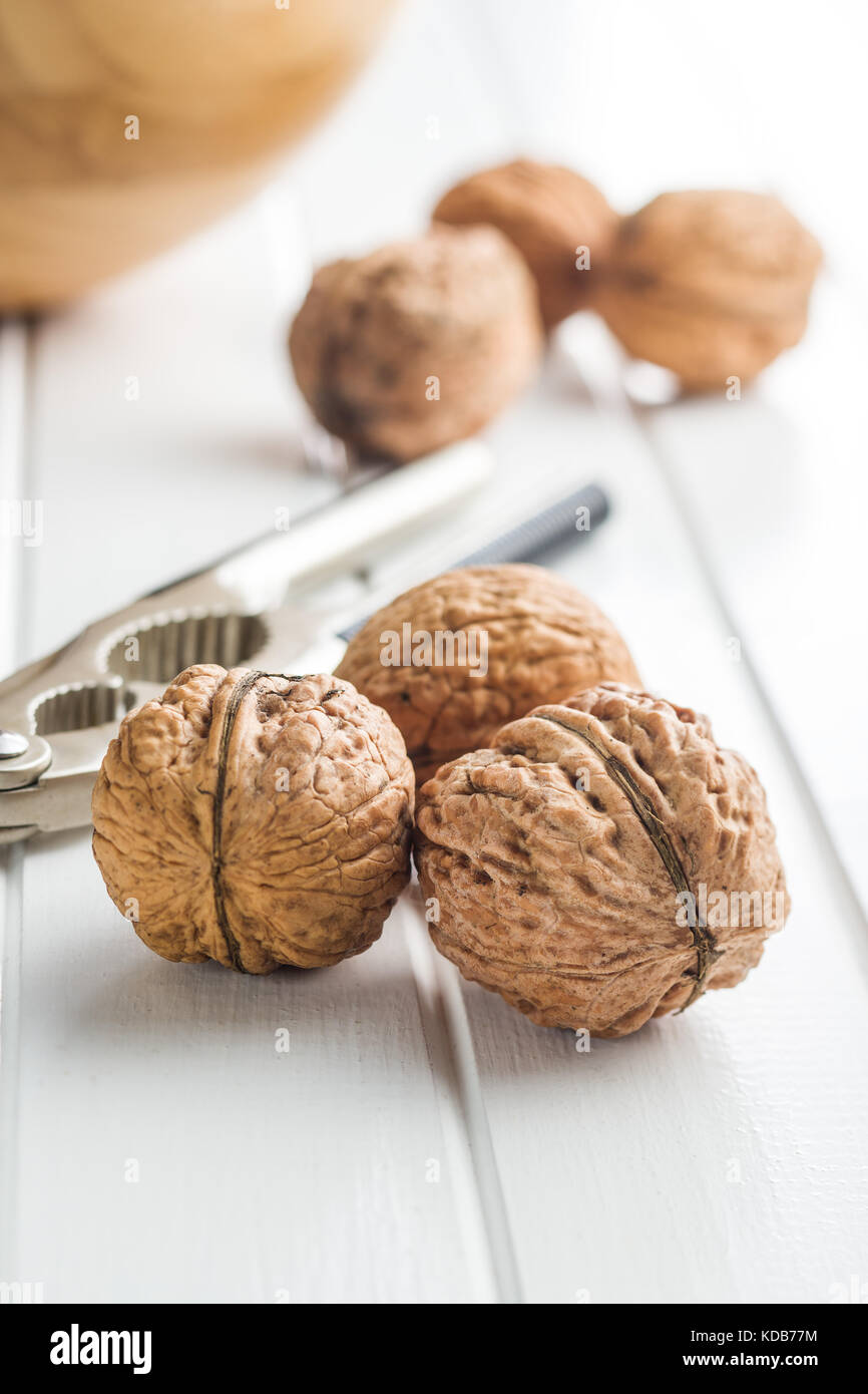 Tasty dried walnuts on white table. - Stock Image