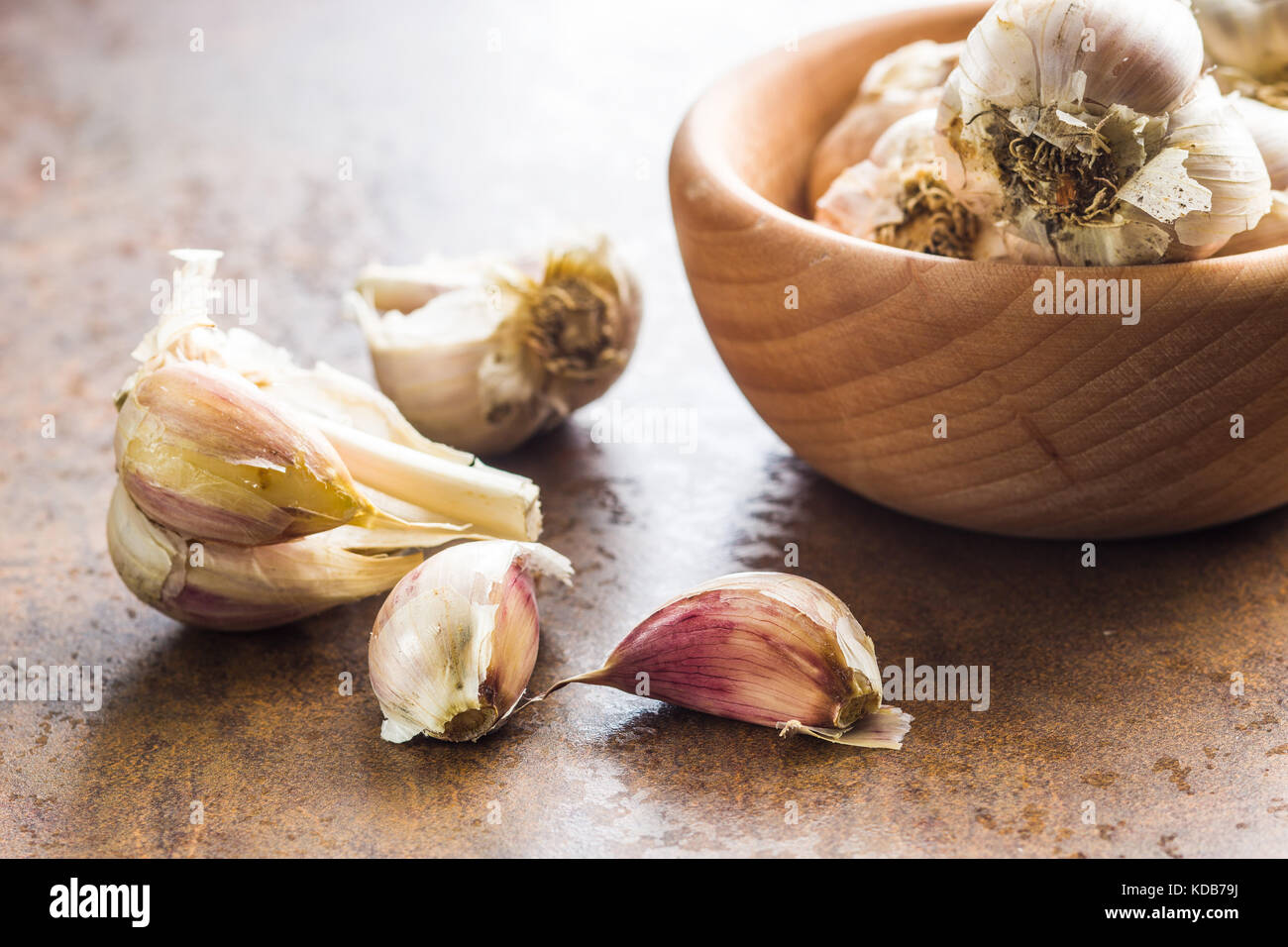 Fresh healthy garlic on kitchen table. - Stock Image