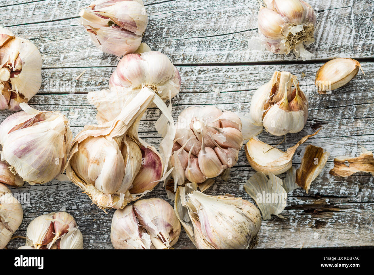 Fresh healthy garlic on old wooden table. Top view. - Stock Image