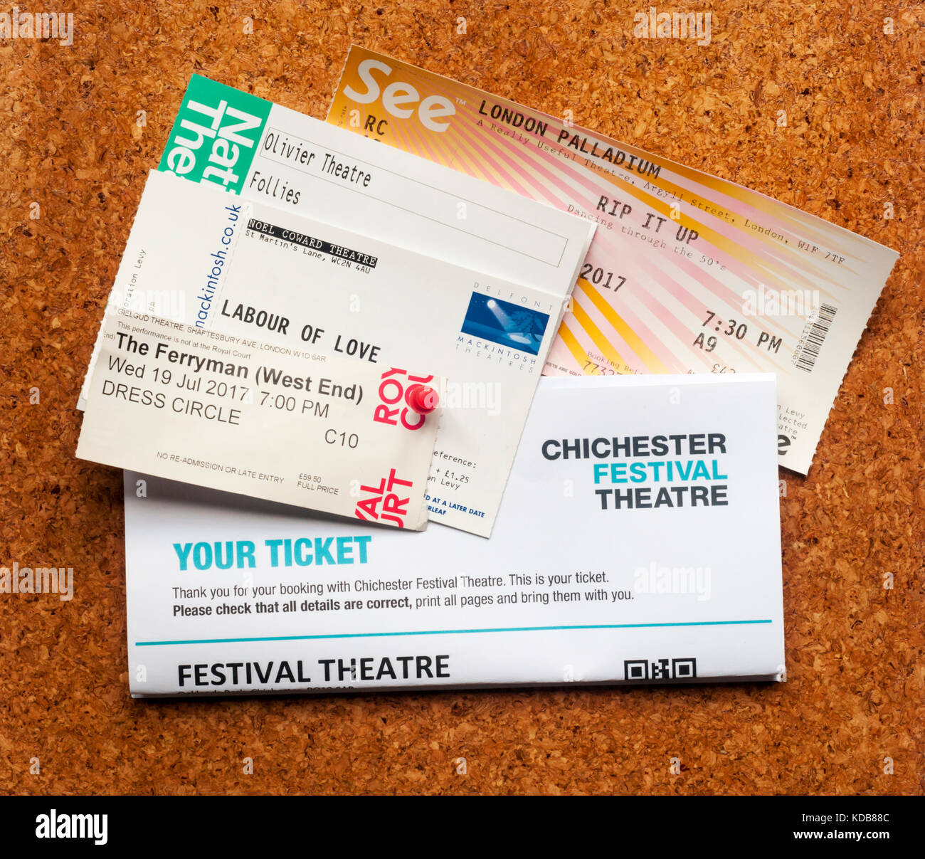A selection of theatre tickets pinned to a noticeboard. - Stock Image