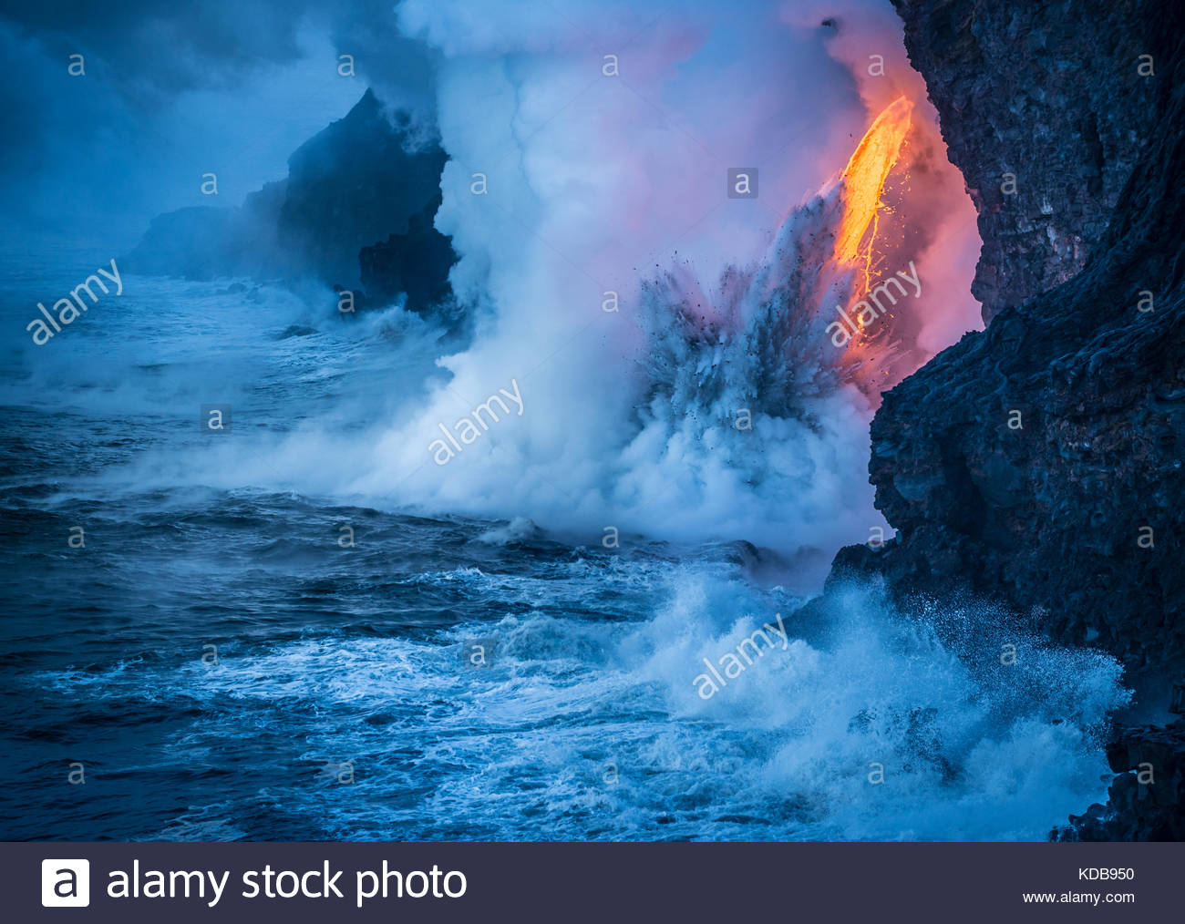 Lava falling from sixty feet creates an explosion from the heat and pressure of super heated water. Stock Photo