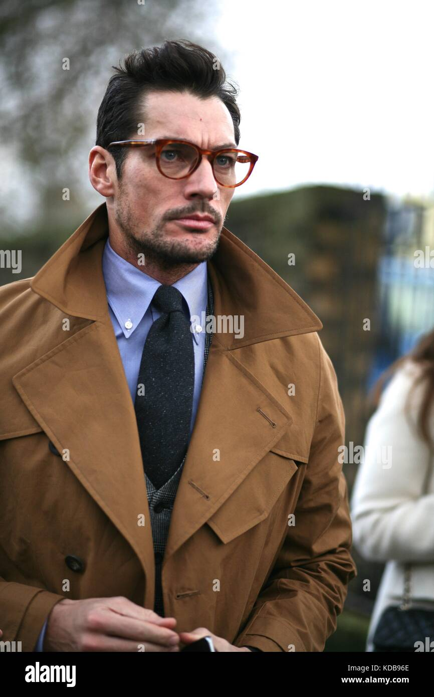 David Gandy wearing spectacles and a trench coat during Mens Fashion Week . London  Jan 2016 Street Style ***for - Stock Image