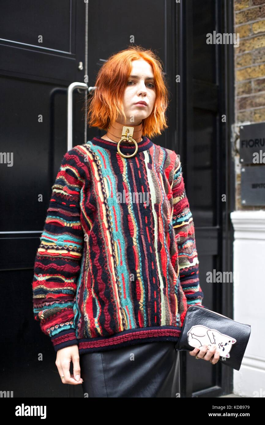 Young fashion woman with wavy bob posed outside front door during London Fashion week London 2016 ***for editorial - Stock Image