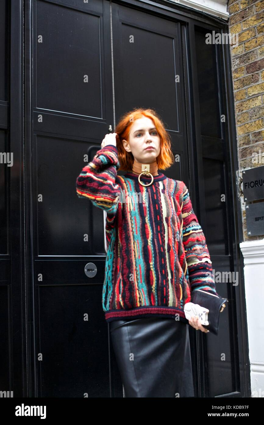 Fashionable woman poses in front of outside door during London Fashion Week 2016 street style ***for editorial use - Stock Image