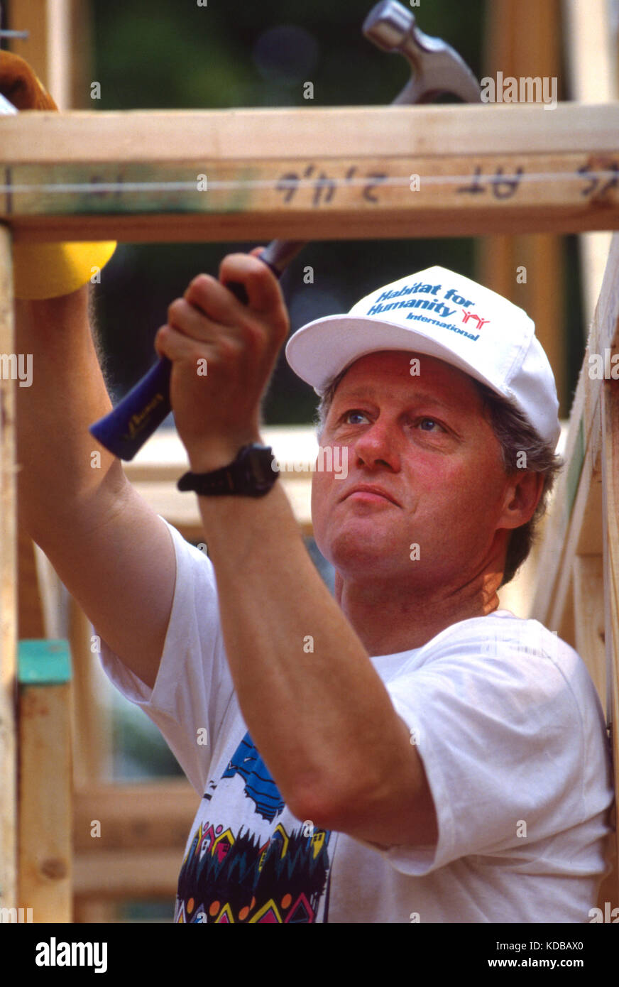 President Bill Clinton works to frame a house during a Habitat for Humanity house in Atlanta, Georgia. The build - Stock Image