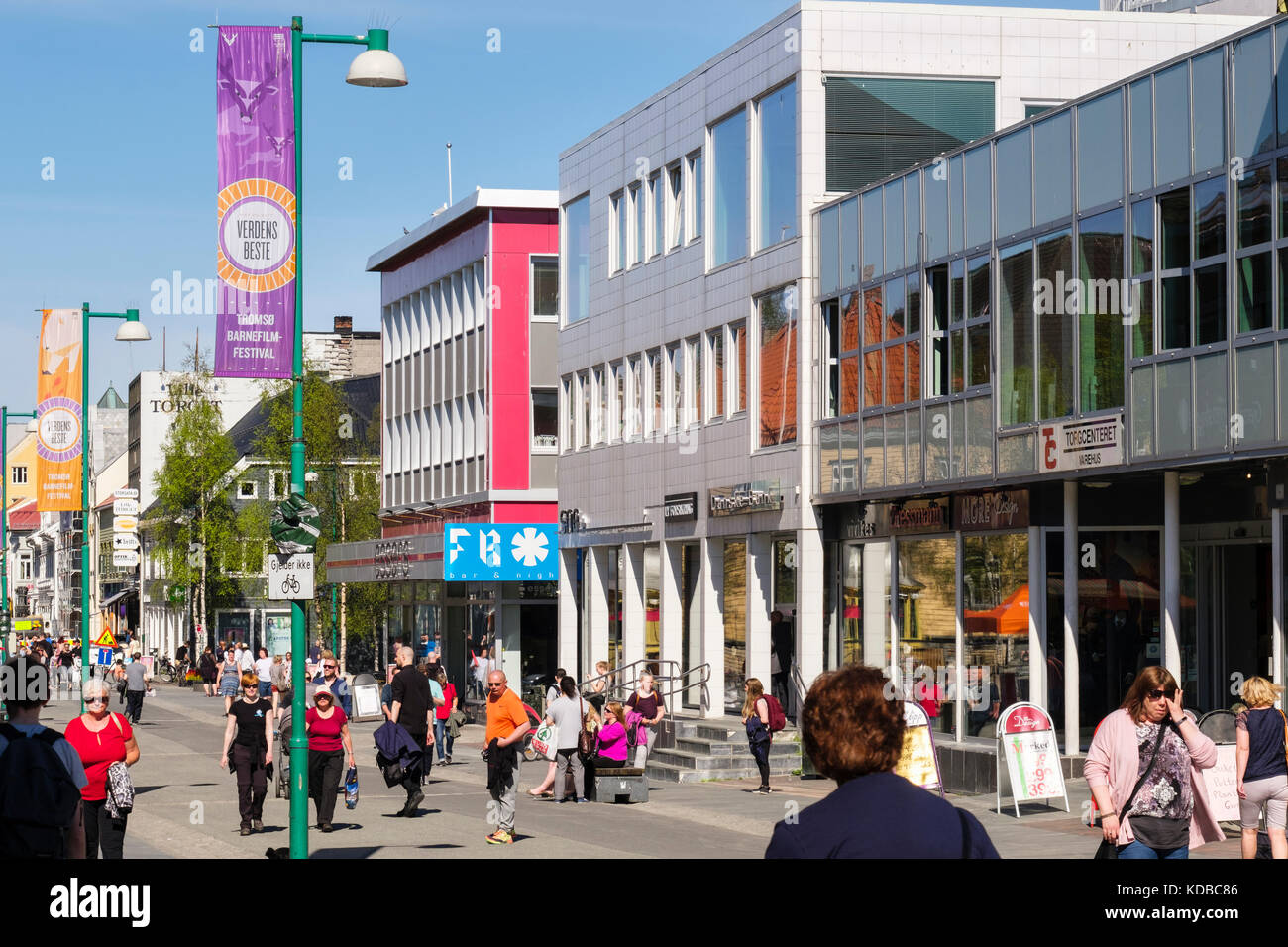 Busy street scene with shoppers and modern shops in city centre. Storgata, Tromso, Troms county, Norway, Scandinavia - Stock Image