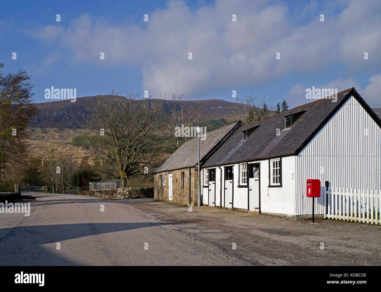 Picturesque old stables next to red post box at Achfary, on the Duke of Westminster's Reay Forest Estate, Sutherland, - Stock Image