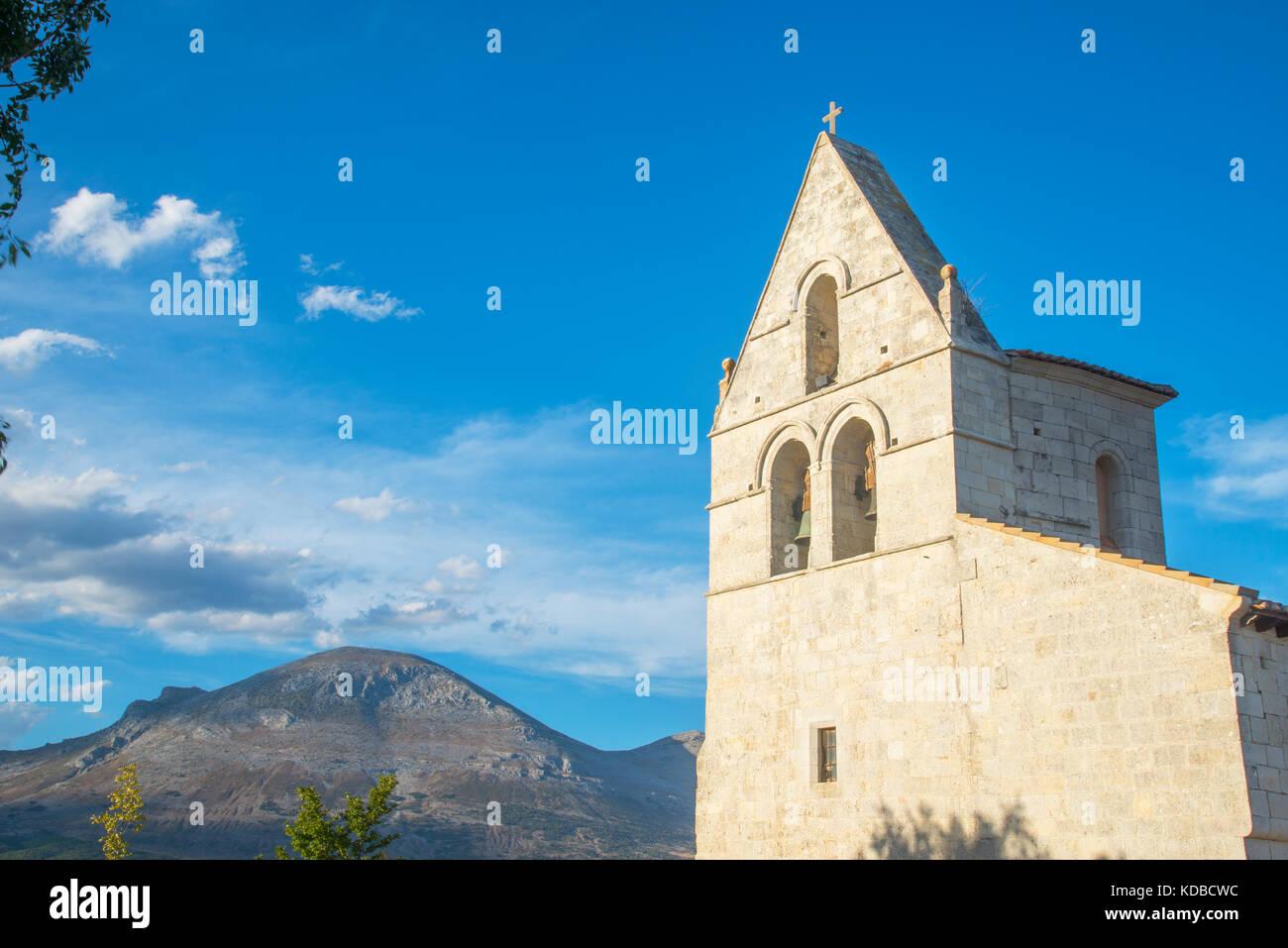Steeple of the church and view of Peña Redonda. Pison de Castrejon, Palencia province, Castilla Leon, Spain. - Stock Image