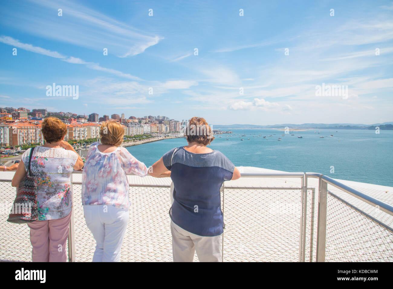 Three mature women at the viewpoint on Botin Center. Santander, Spain. - Stock Image