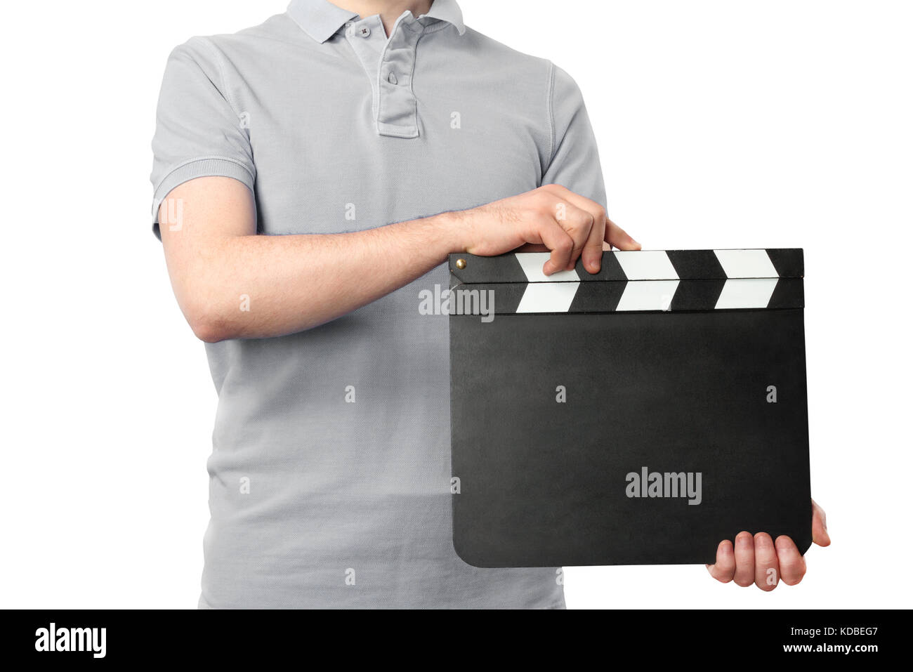 Man holding blank cinema clapper board isolated on white background - Stock Image