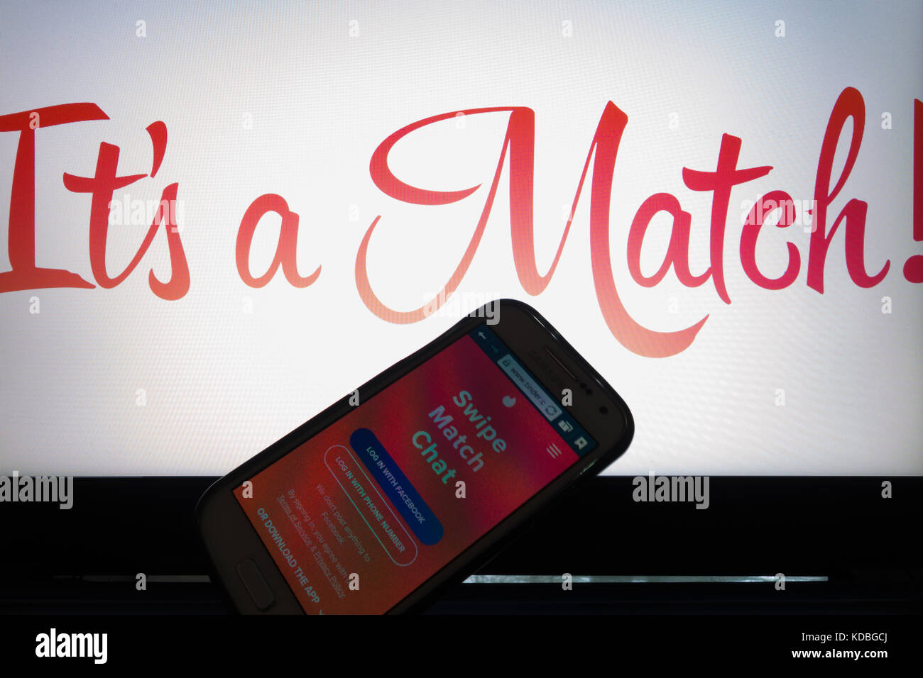 A smartphone display shows Tinder application web login - Stock Image
