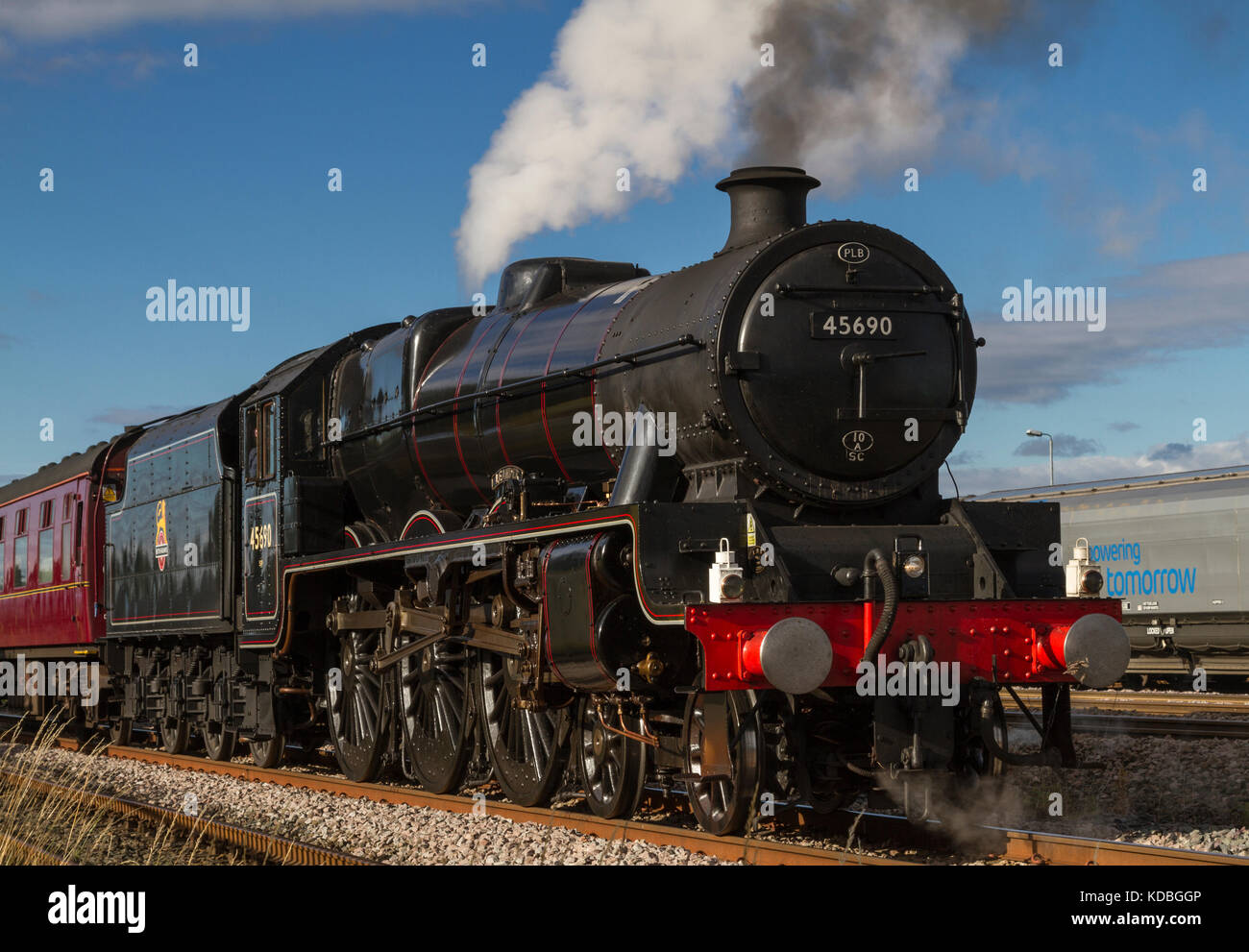 Leander 45690, in BR late 1940's lined black livery, on The Coast To Coast Express at Milford Loop, North Yorkshire, - Stock Image