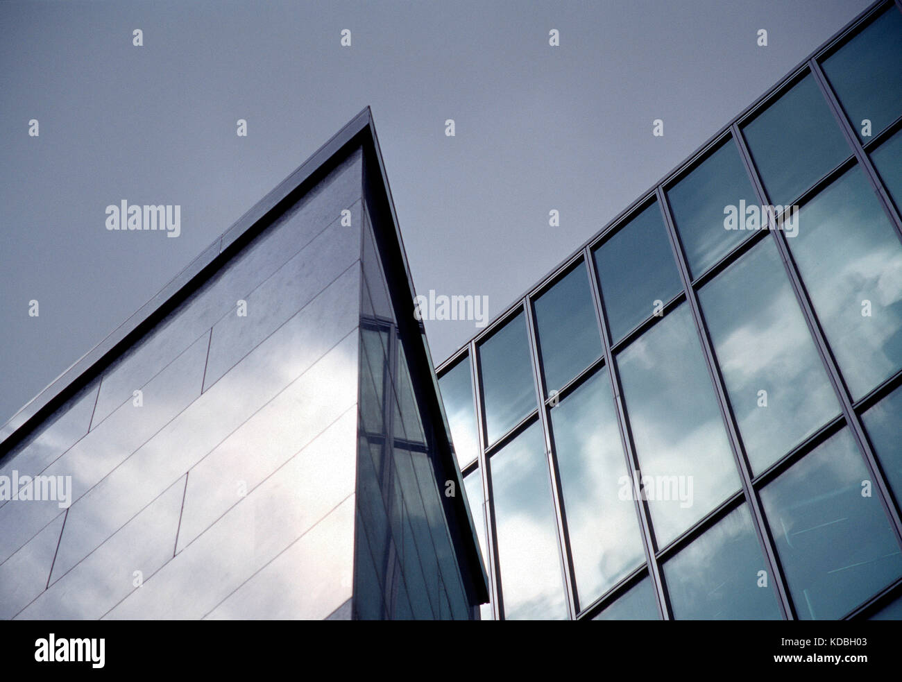 Architecture. Low angle viewpoint of glass façade  section of modern commercial building. - Stock Image