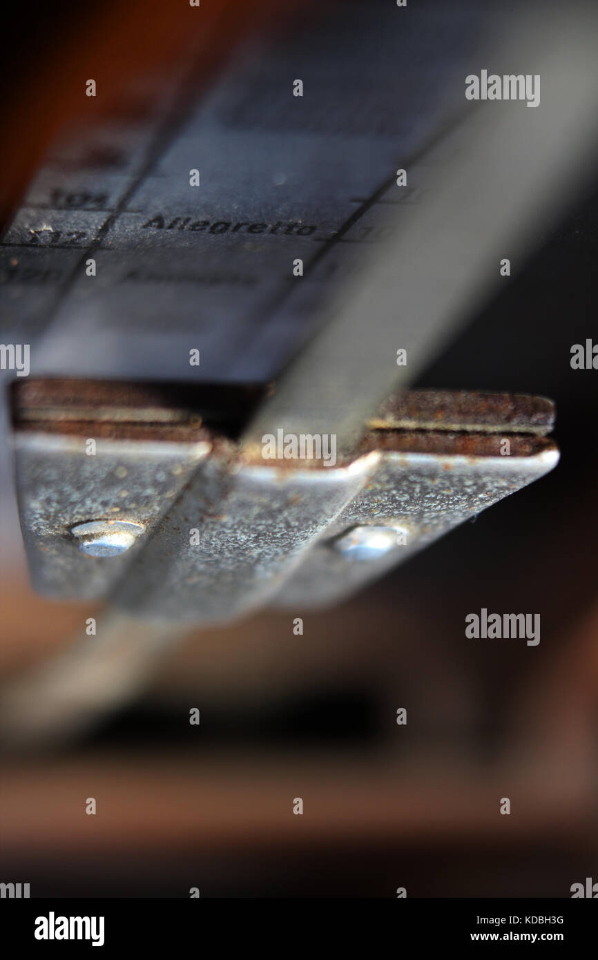 Old metronome close-up - Stock Image