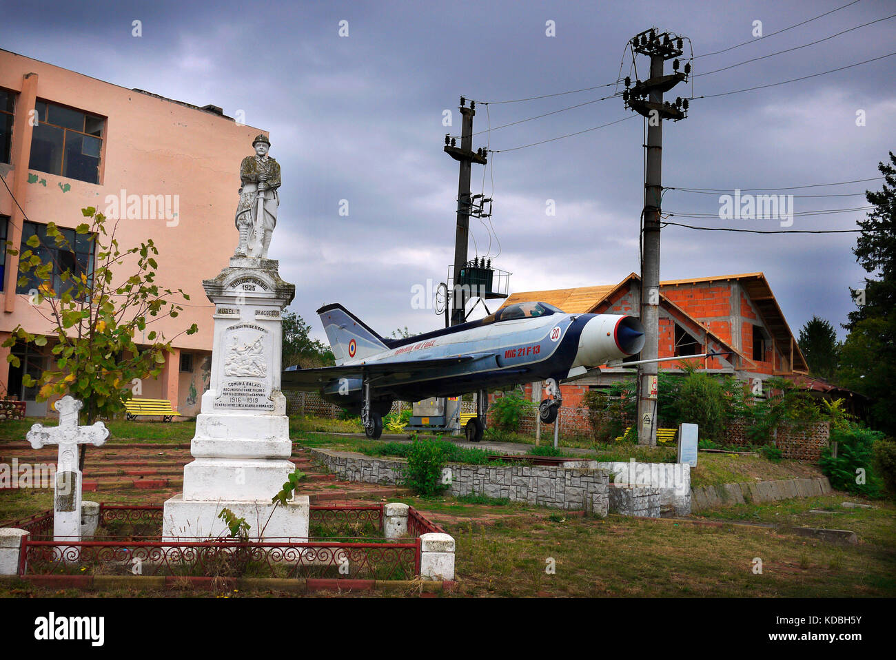 Romanian Air Force Mig 21 jet fighter on display at a memorial in the village of Balaci in Romania. - Stock Image