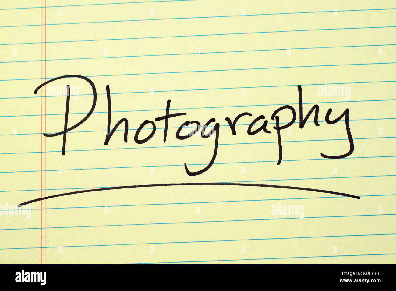 The word 'Photography' underlined on a yellow legal pad - Stock Image