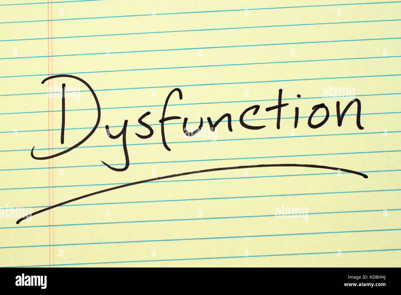 The word 'Dysfunction' underlined on a yellow legal pad - Stock Image