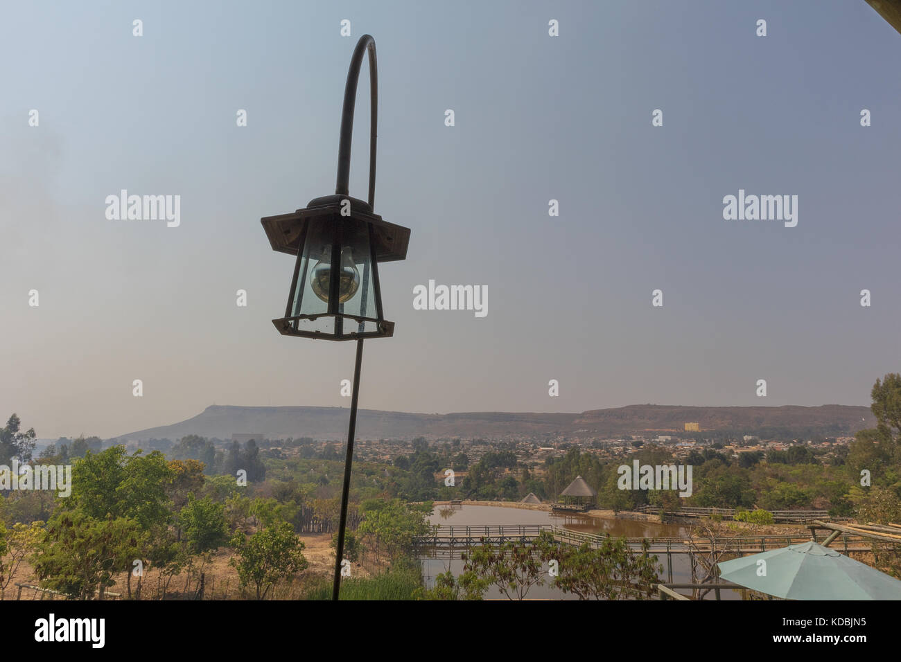 Old lamp with mountain view. Stock Photo