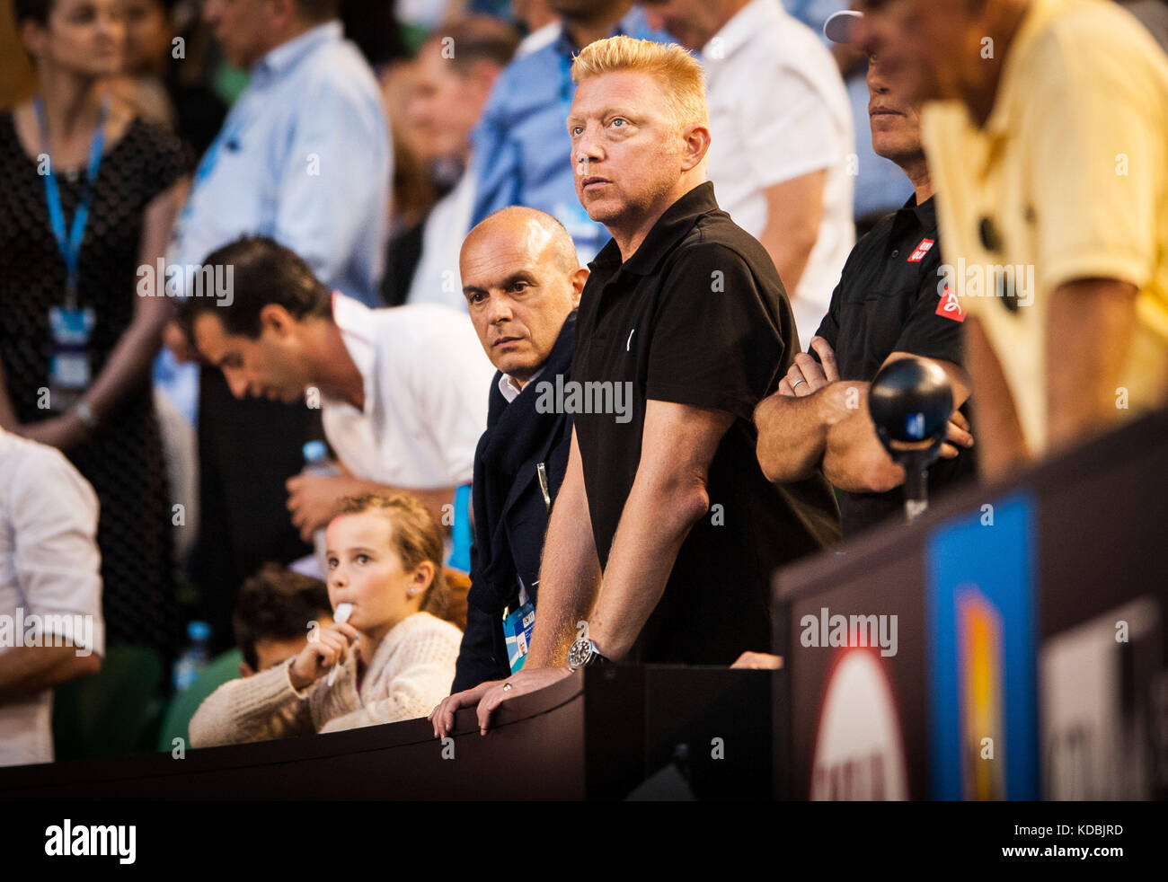 Tennis legend Boris Becker - in black shirt -watches as his student - Novak Djokovic (SRB) went up against unseeded - Stock Image