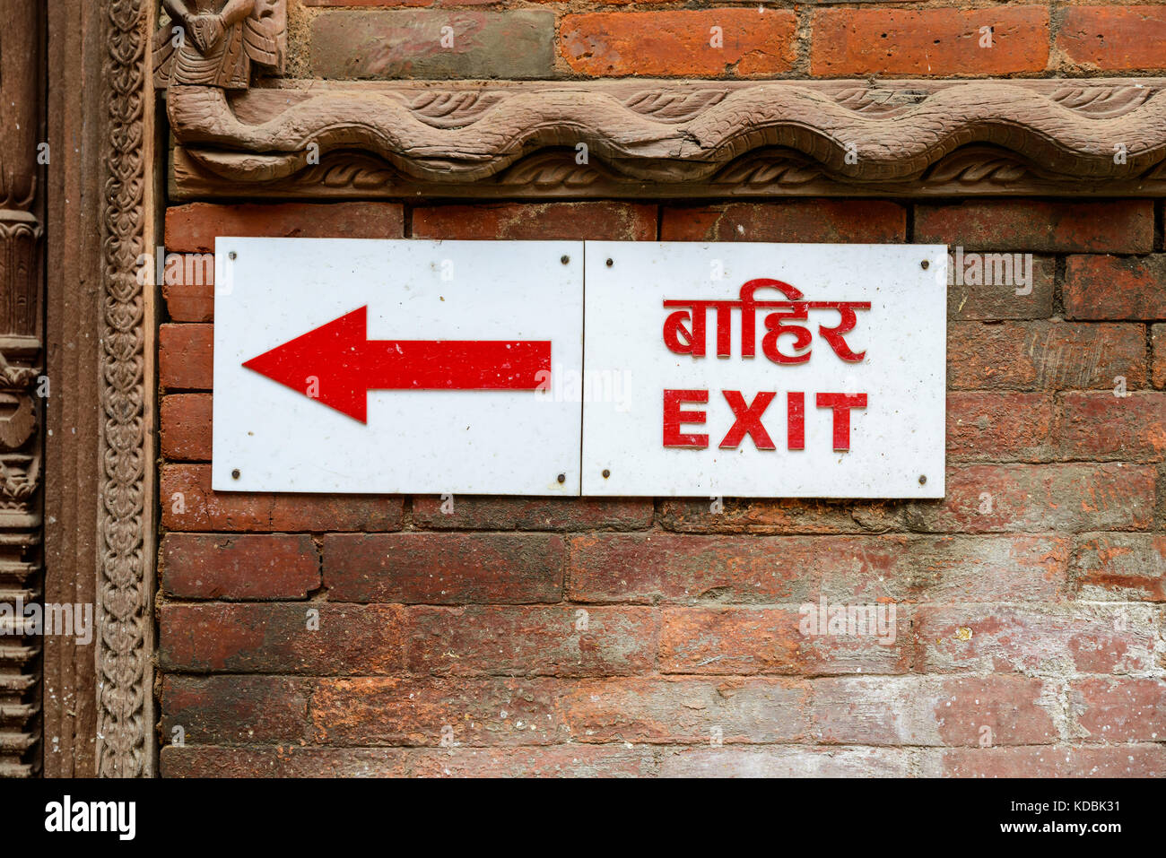 Exit sign and arrow in nepali and english - Stock Image