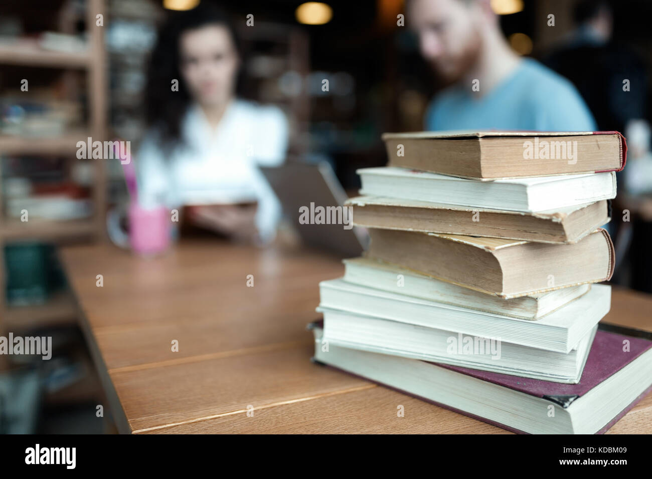 Portrait of students studying in bookstore together Stock Photo