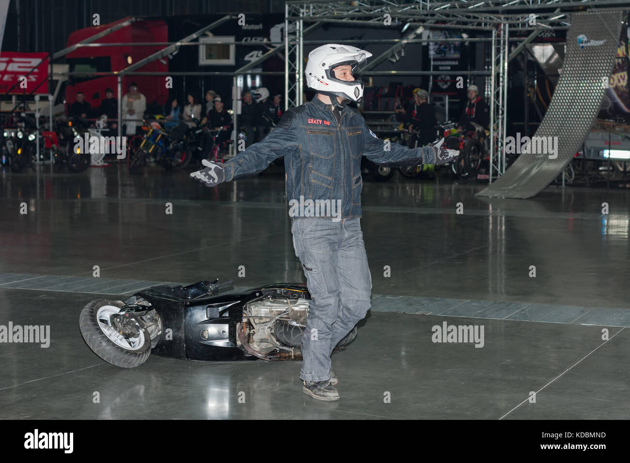 BRNO, CZECH REPUBLIC-MARCH 4,2016: Stuntman with a scooter during stunt show on International Fair for Motorcycles - Stock Image