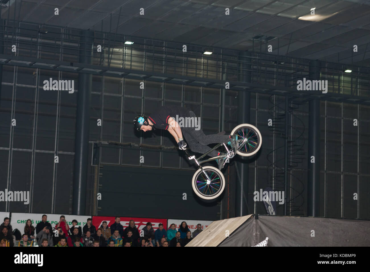 BRNO, CZECH REPUBLIC-MARCH 4,2016: Stuntman riding a bike during stunt show on International Fair for Motorcycles - Stock Image