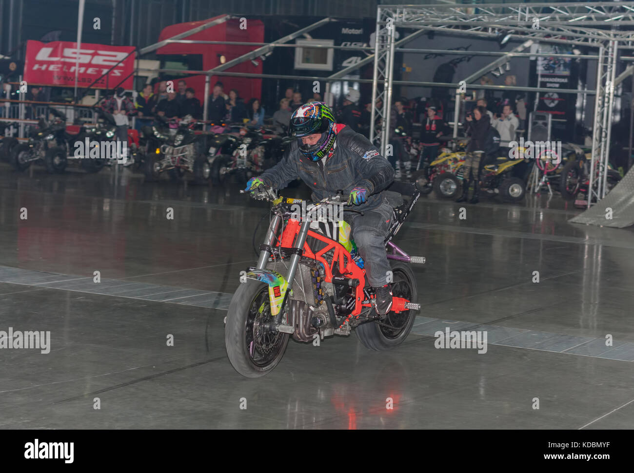 BRNO, CZECH REPUBLIC-MARCH 4,2016: Stuntman riding a motorcycle during stunt show on International Fair for Motorcycles - Stock Image