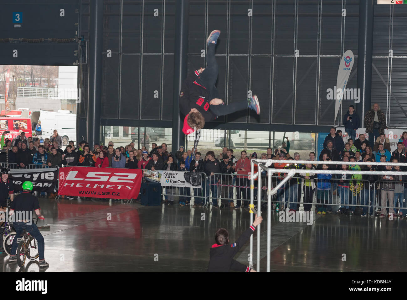BRNO, CZECH REPUBLIC-MARCH 4,2016: Stuntman jumping during stunt show on International Fair for Motorcycles  on - Stock Image