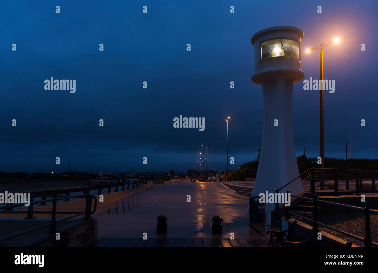 Insure lighthouse at night in Littlehampton, West Sussex, England, UK. - Stock Image