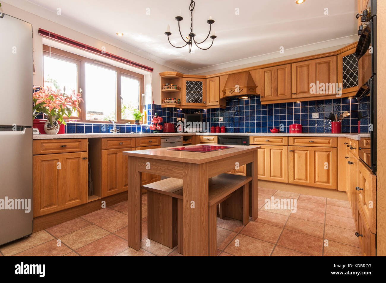 Traditional Farmhouse Kitchen With Blue Tiles And Pine Fitted Stock Photo Alamy