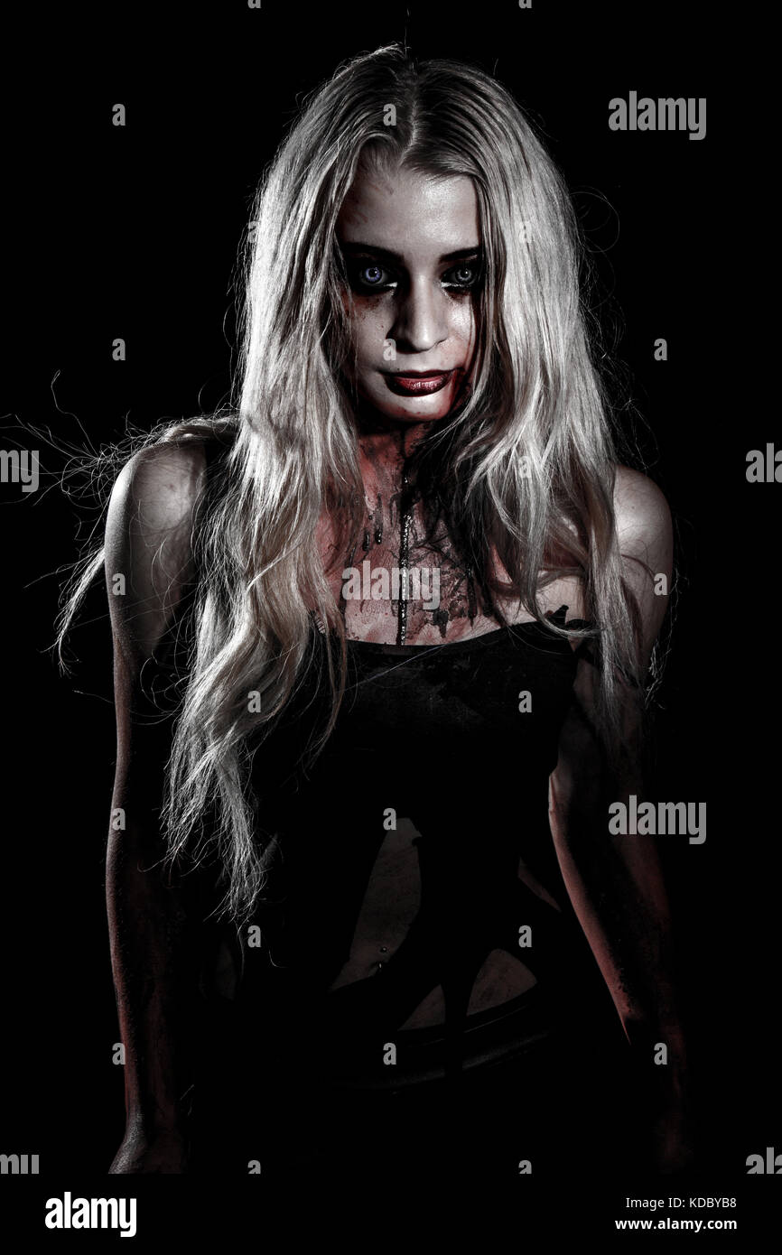 Pale bloody woman over black background Stock Photo