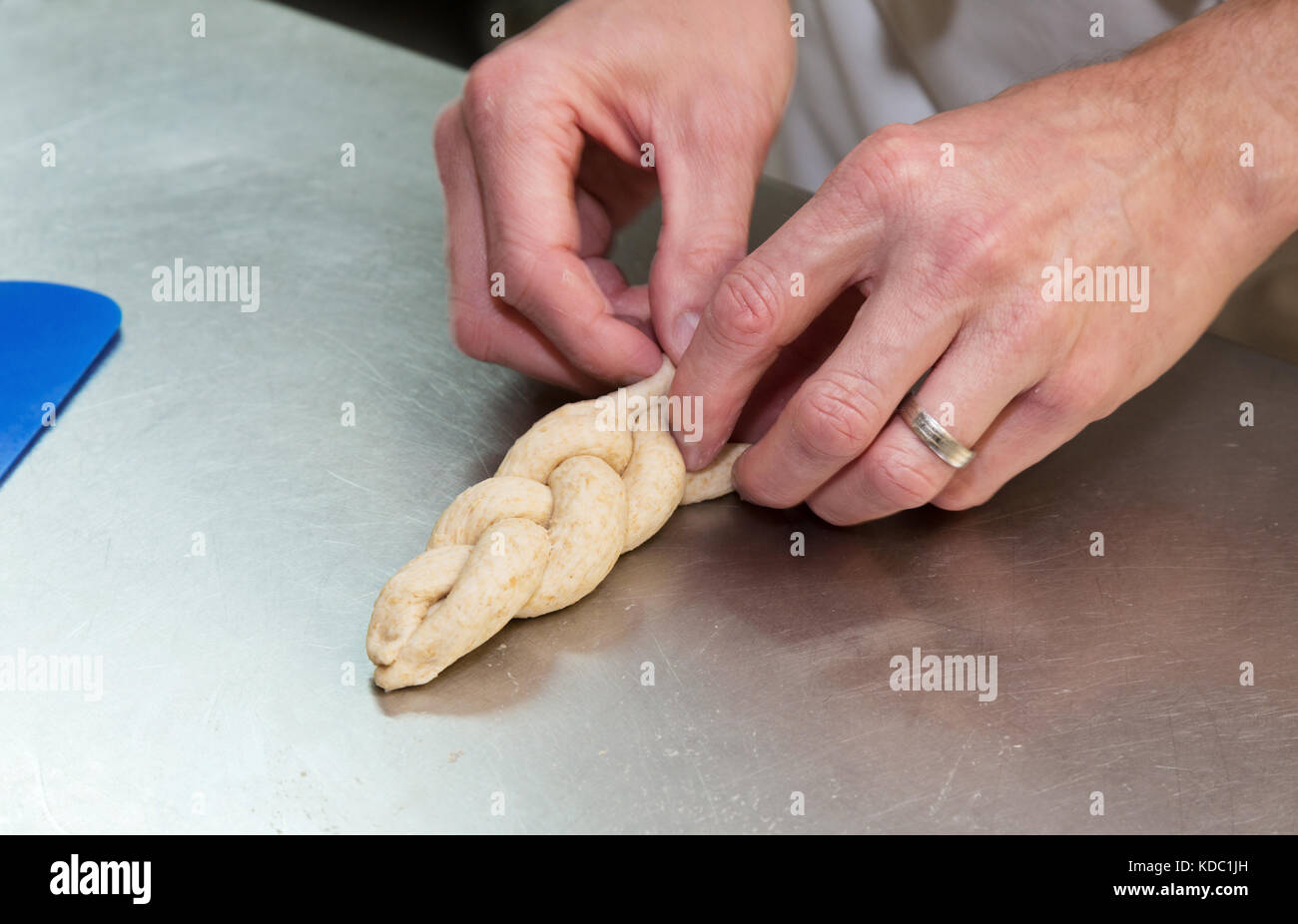 Bread making - making shaped bread rolls with dough, UK - Stock Image