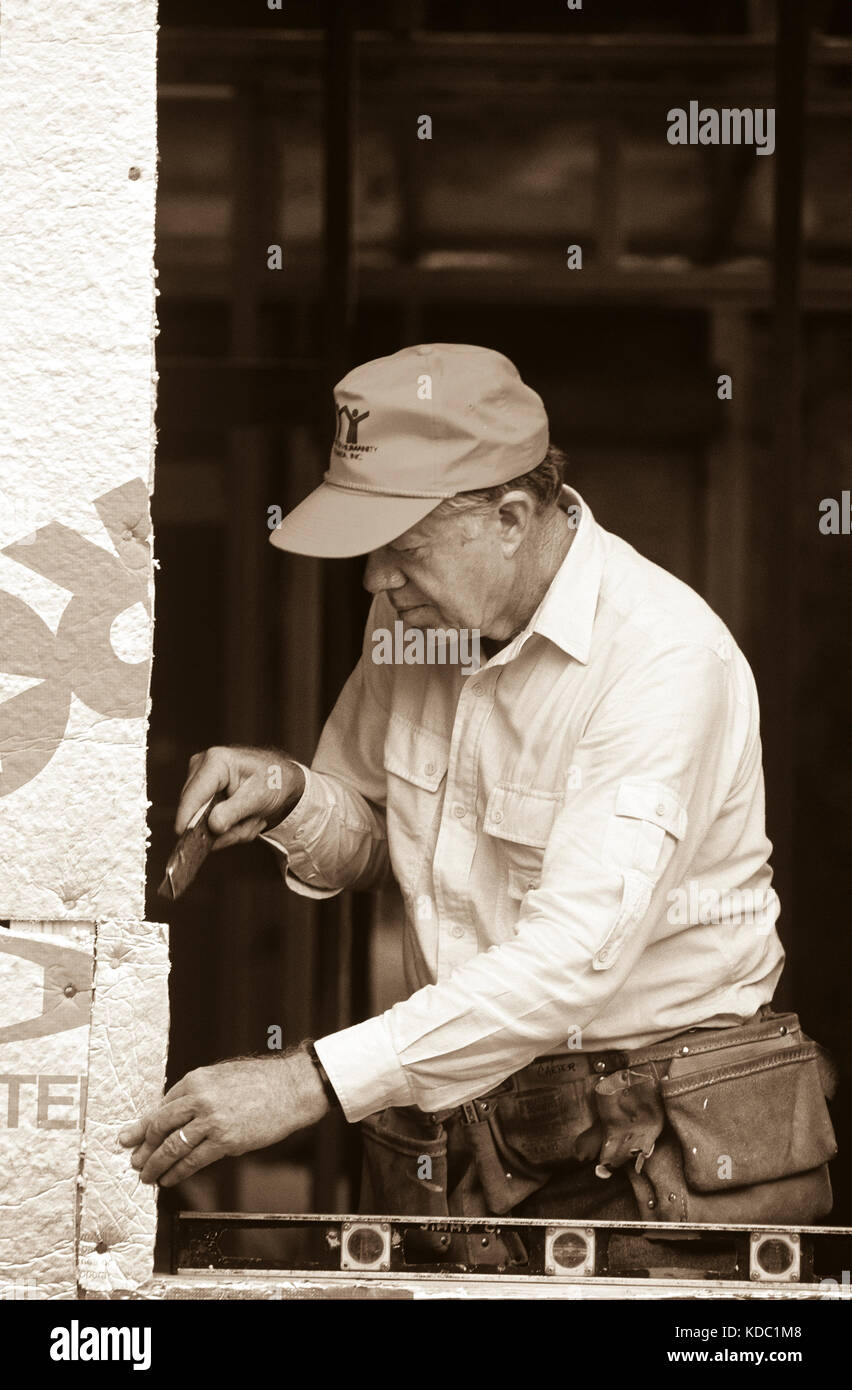 Former President Jimmy Carter works on Habitat for Humanity house in Atlanta, Georgia. Carter is a founding board - Stock Image