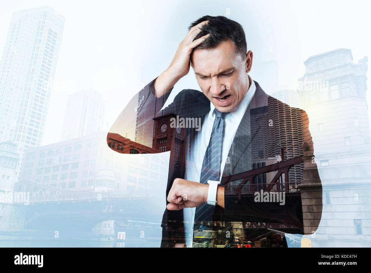 Irritated busy man having too little time - Stock Image